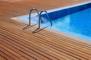 Swimming pool with teak flooring